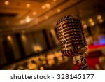 vintage gold microphone  in... | Shutterstock . vector #328145177