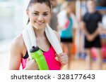 fit woman smiling at camera at... | Shutterstock . vector #328177643