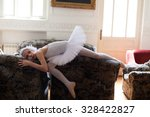 Young Ballerina Posing On A Sofa