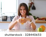 Young Woman Sitting A Table  I...