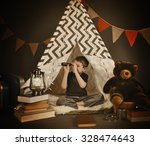 a boy is sitting in a tepee... | Shutterstock . vector #328474643