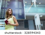young woman at the airport | Shutterstock . vector #328594343