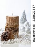 Small photo of Natural christmas decoration with candle and pineal.