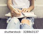 gir with booksl writing in the... | Shutterstock . vector #328863137