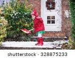 Little Girl Shoveling Snow On...
