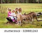 Happy Children Feeding Kangaro...