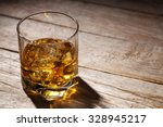 glass of whiskey with ice on... | Shutterstock . vector #328945217