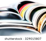 stack of the colorful magazines | Shutterstock . vector #329015807