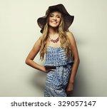 beautiful woman in  straw... | Shutterstock . vector #329057147