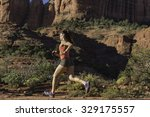woman trail running | Shutterstock . vector #329175557
