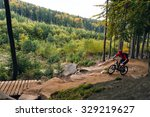 mountain biker riding on bike... | Shutterstock . vector #329219627