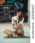 portrait of young girl posing... | Shutterstock . vector #329284667