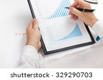 businessman counting losses and ... | Shutterstock . vector #329290703