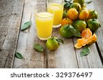 organic tangerines and juice on ... | Shutterstock . vector #329376497