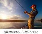 Young Man Fishing On The Pond...