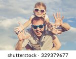 father and daughter playing in... | Shutterstock . vector #329379677