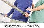 hands of old woman on handles... | Shutterstock . vector #329394227