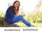 girl autumn leaves casual player | Shutterstock . vector #329559413