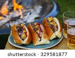 Hot Dogs With The Camp Fire In...