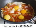 Four Eggs With Red Stewed...