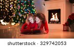 mother and daughter read a book ...   Shutterstock . vector #329742053