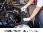 Small photo of Mechanic changing oil