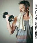 senior man lifting weights  | Shutterstock . vector #329799113