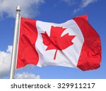Canadian Flag Waving On The...