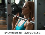 athletic strong  woman lifting... | Shutterstock . vector #329924153