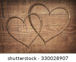 Two Wooden Hearts Placed On A...