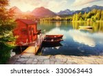 boat on the dock surrounded by... | Shutterstock . vector #330063443