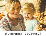 young beautiful blonde mother... | Shutterstock . vector #330344627