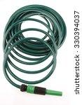 garden hose coiled on plain... | Shutterstock . vector #330394037
