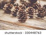 Pinecones On Rustic Wood...