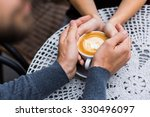 four hands wrapped around a cup ... | Shutterstock . vector #330496097