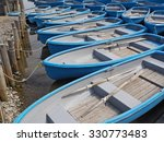 group of blue rowboat at river | Shutterstock . vector #330773483