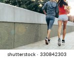 women jogging in city in dusk... | Shutterstock . vector #330842303