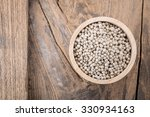 pepper in a bowl on wooden... | Shutterstock . vector #330934163