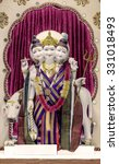 Small photo of Dattatreya idol in Hindu temple. Dattatreya is considered to be an avatar of the three Hindu gods Brahma, Vishnu, and Shiva. Seekers pray to this Supreme Teacher for knowledge of the Absolute Truth.
