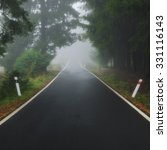empty foggy forest road | Shutterstock . vector #331116143