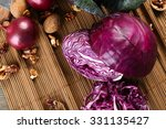 Red Cabbage And Onion On Woode...