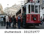 Small photo of ISTANBUL - OCTOBER 19, 2015: Unknown people with traditional red tram trundled along Istiklal Caddesi for 1.64 km connecting Taksim Square with Galatasaray and Tunel Square.