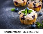 Blueberry Muffins With Powdere...
