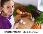a young woman cooking in the...