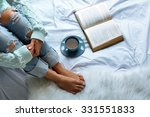 woman on the bed with old book... | Shutterstock . vector #331551833