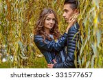 cute young couple under yellow... | Shutterstock . vector #331577657