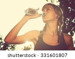 jogger drinking water after... | Shutterstock . vector #331601807