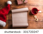 Empty wishlist for Santa Claus laid on a wooden table