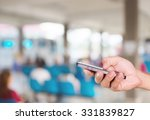 mobile hold in hand with blur... | Shutterstock . vector #331839827