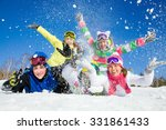 Group Of Teens Playing On Snow...
